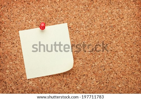 Blank sticky paper on cork wood notice board with copy space - stock photo