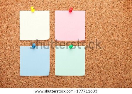 Blank sticky papers on cork wood notice board - stock photo