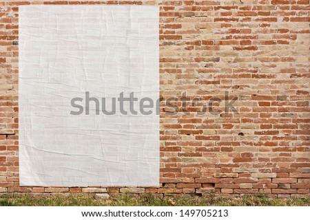 blank street advertising billboard stuck on brick wall - stock photo
