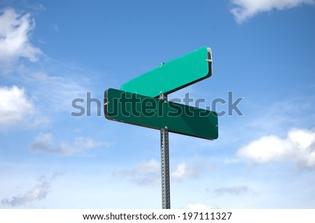 blank street sign against sky and clouds - stock photo