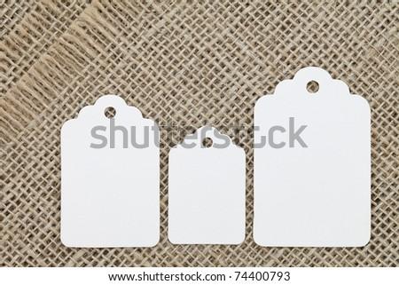 Blank tag on burlap background - stock photo