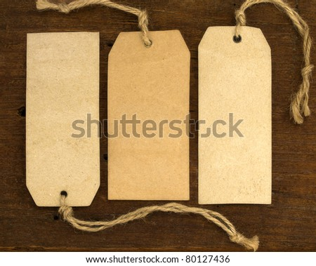 blank tags on the wooden background - stock photo