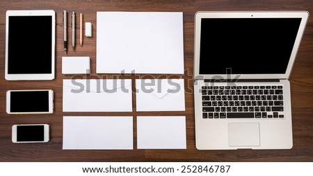 Blank Template. Consist of Laptop,Business cards, letterhead a4, Tablet PC, eraser ,pen,pencil,envelopes and smart phones. - stock photo