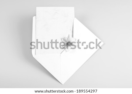 Blank thank you or greeting card in envelope with flower - stock photo