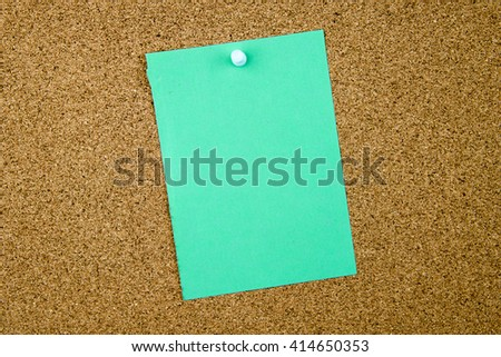 Blank turquoise paper note pinned on cork board with red thumbtack, copy space available - stock photo