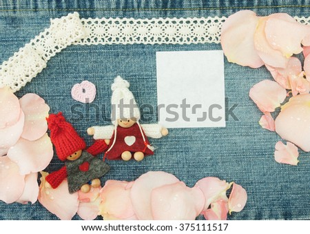 Blank, valentine, greeting card with couple in love, little pink heart and soft pink rose petals. On the denim valentine's day background. Handmade concept - stock photo