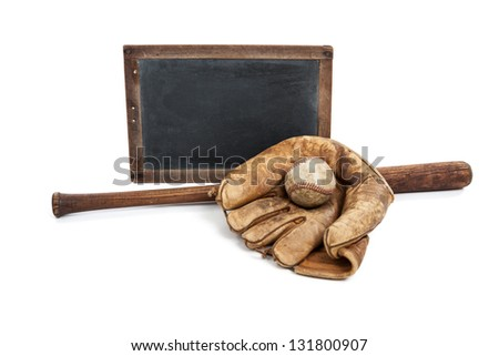 Blank vintage chalkboard with vintage wooden bat, ball and glove isolated on white - stock photo