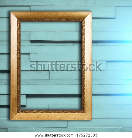 Blank vintage frame on wooden wall background with spot light   - stock photo