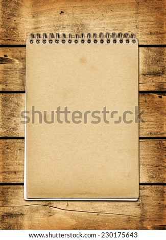 Blank vintage notebook on a wood board panel - stock photo
