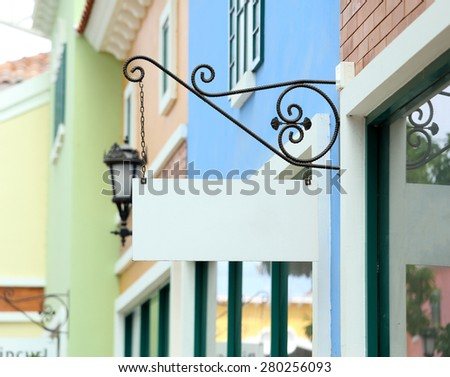 blank vintage sign on wall of traditional building - stock photo