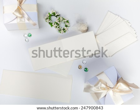 Blank wedding card with white boxes, envelopes and orange blossom - stock photo