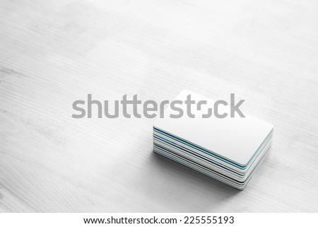 blank white bank card & pile of Credit cards and Bank Cards on white wood - stock photo