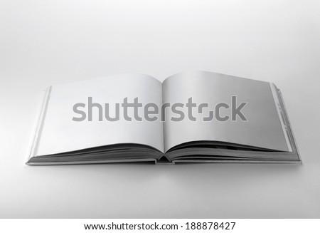Blank white book open on white background - stock photo