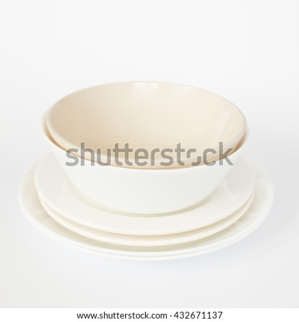 Blank white bowls and dishes  on isolated white  background. - stock photo