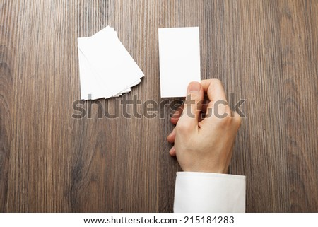 Blank White business card in a hand Man on isolated white background   added clipping path changeable backgorund color and business card color. - stock photo