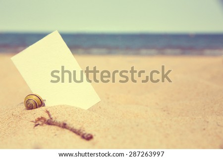 Blank white card on the beach background. Instagram effect - stock photo