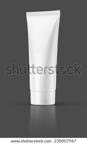 Blank white cosmetic tube isolated on gray background - stock photo