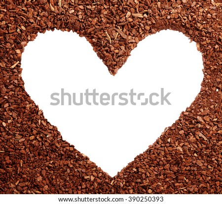 Blank white heart symbol with copy space surrounded by pine bark mulch wood chips for romance or symbolic earth day greeting - stock photo