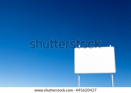 Blank white metal advertising billboard on blue sky background - stock photo