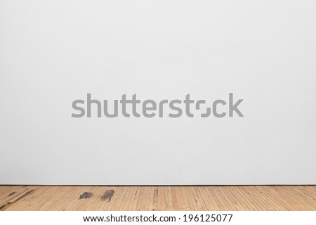Blank White Museum Wall With Wooden Floor - stock photo