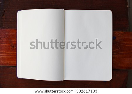 Blank white notebook with copyspace - stock photo