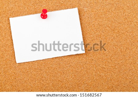 Blank white paper note with red pin on corkboard - stock photo