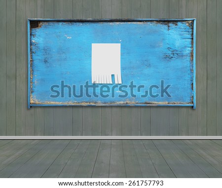 Blank white paper posted on old blue weathered noticeboard with dark green wood wall and floor background. Marked with your own message. - stock photo