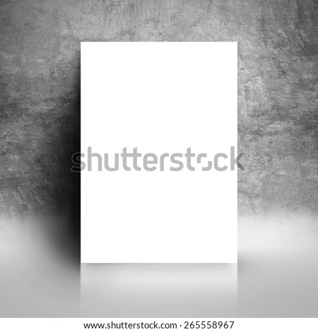 Blank White Paper Poster Leaning on Grunge Gray Studio Room Wall as Copy Space for Design and Template Mock up for Adding Your Text. - stock photo