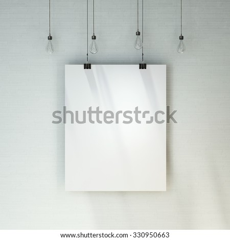 Blank white poster on brick wall hanging under decorative vintage light bulbs. - stock photo