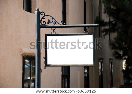 Blank white sign with a copy space area hanged from a pole - stock photo