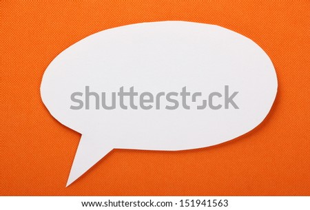 Blank white speech or talking bubble made from white paper against an orange textured background, with room for your text. - stock photo