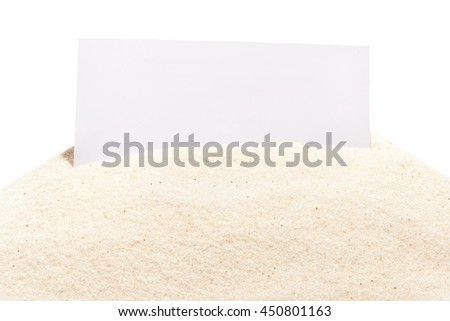 Blank white visit card on pile of beach sand, isolated on white background - stock photo
