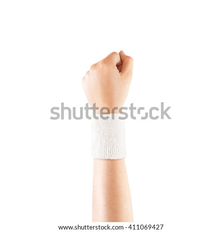 Blank white wristband mockup on hand, isolated. Clear sweat band mock up design. Sport sweatband template wear on wrist arm. Sports support protective bandage wrap. Bangle on the tennis player. - stock photo