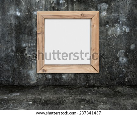 blank whiteboard with wooden frame on dark mottled concrete wall and floor background - stock photo