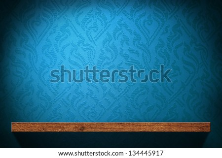 Blank Wood shelf with blue retro wallpaper background - stock photo