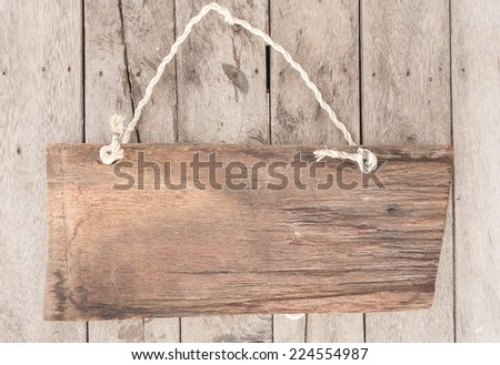 blank wood sign board on rope with space for text - stock photo