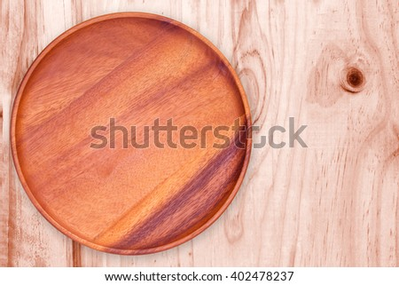 blank wood tray / empty wood plate on wood table background / can be used display your product / Top view. - stock photo