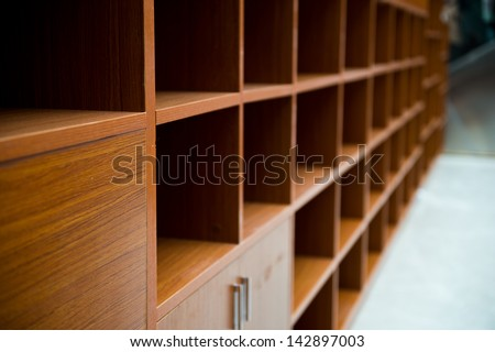 Blank wooden bookshelf in a library. - stock photo