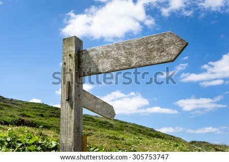 Blank Wooden Direction Signs and Blue Sky - stock photo