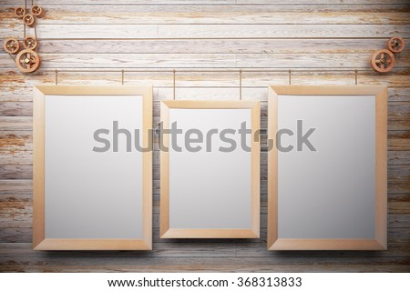 Blank wooden picture frames on wooden wall, mock up - stock photo