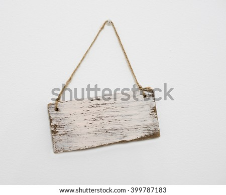 blank wooden sign hanging on the wall - stock photo
