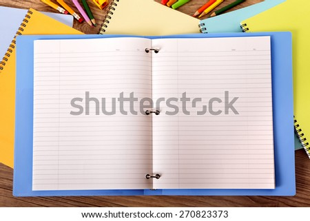 Blank writing book ring binder, student desk, copy space - stock photo