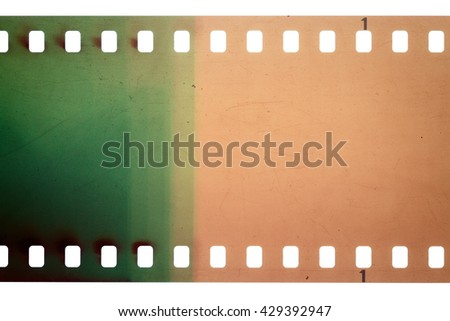 Blank yellow and green vibrant noisy film strip texture background - stock photo