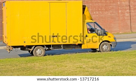 blank yellow big delivery truck on road - stock photo