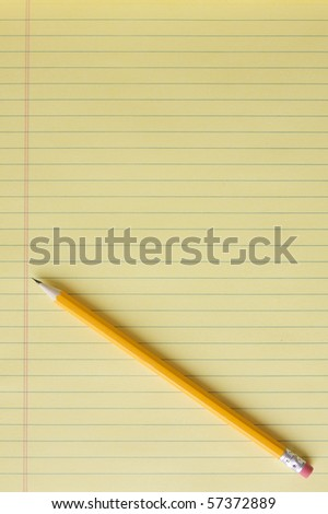 Blank yellow lined legal pad with yellow number 2 pencil placed at a diagonal.  Portrait orientation. - stock photo