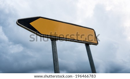 Blank yellow road sign with left pointing arrow. - stock photo