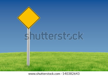 Blank yellow sign on green field - stock photo