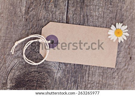Blanket ecotag on wooden background - stock photo