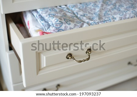 Blanket in an open drawer - stock photo