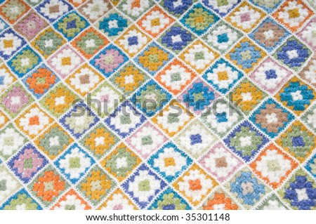 Blanket made of granny Squares - stock photo